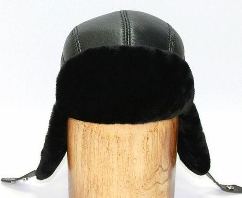 Черная шапка-ушанка из мутона комбинированная с кожей